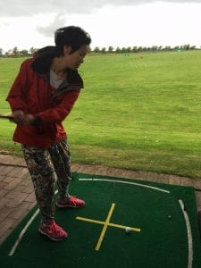 Dyanne playing golf